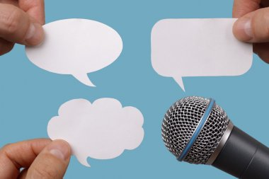 Blank speech bubbles with microphone