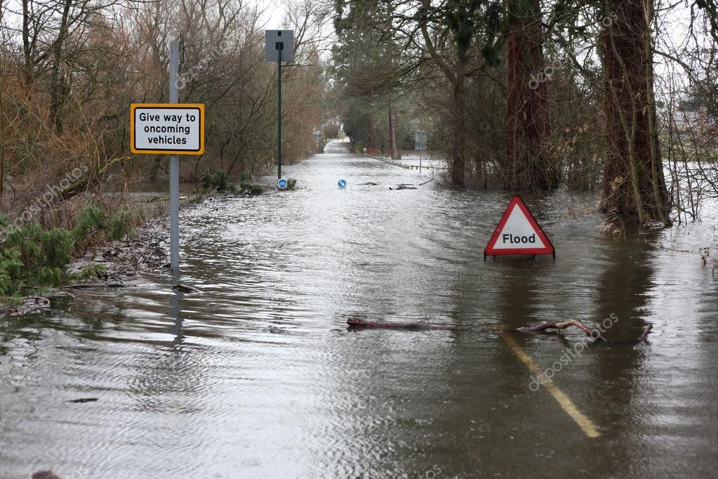 Flood sign in road