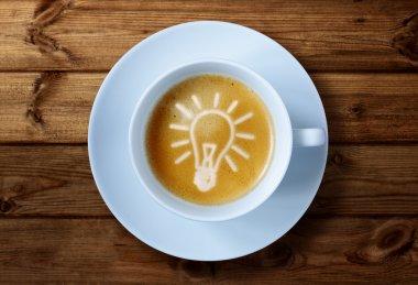 Coffee cup with light bulb idea
