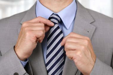 Businessman fixing tie