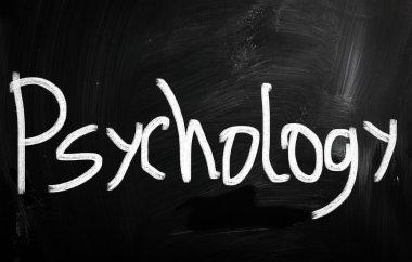 'Psychology' handwritten with white chalk on a blackboard