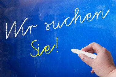 Person writing on chalk board