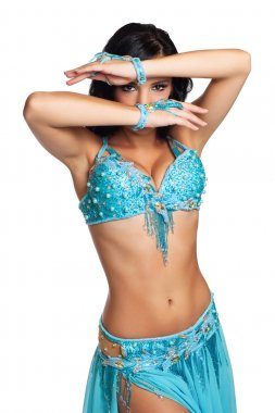 Mysterious belly dancer wearing a light blue costume