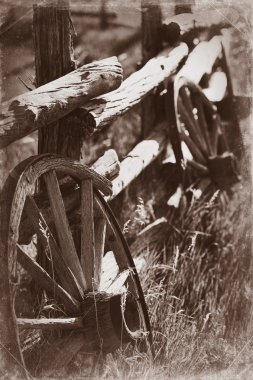 Antique Wagon Wheels and Wood Fence