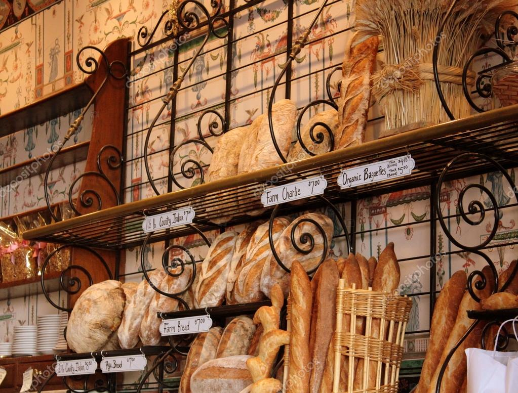 Fresh, crusty breads and baguettes on display at a local bakery,where you can smell them cooking in the oven all day long.