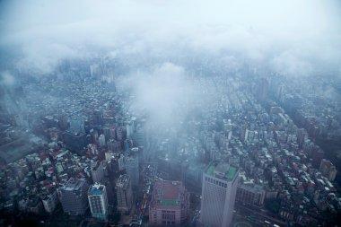 King of the clouds overlooking Taipei 101 Tower in Taipei, Taiwan