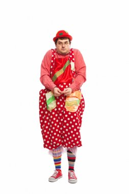 Funny adult dressed in clown isolated on white