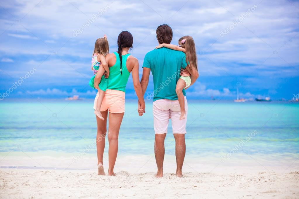 Back view of young family looking to the sea in Philippines