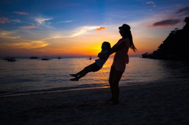 Silhouette of mother and little daughter on Boracay, Philippines