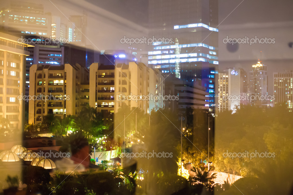 Night View Of Big City Outside The Window Stock Photo