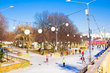 General view of people skating on ice rink