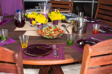 Beautiful home served table for dinner on the veranda