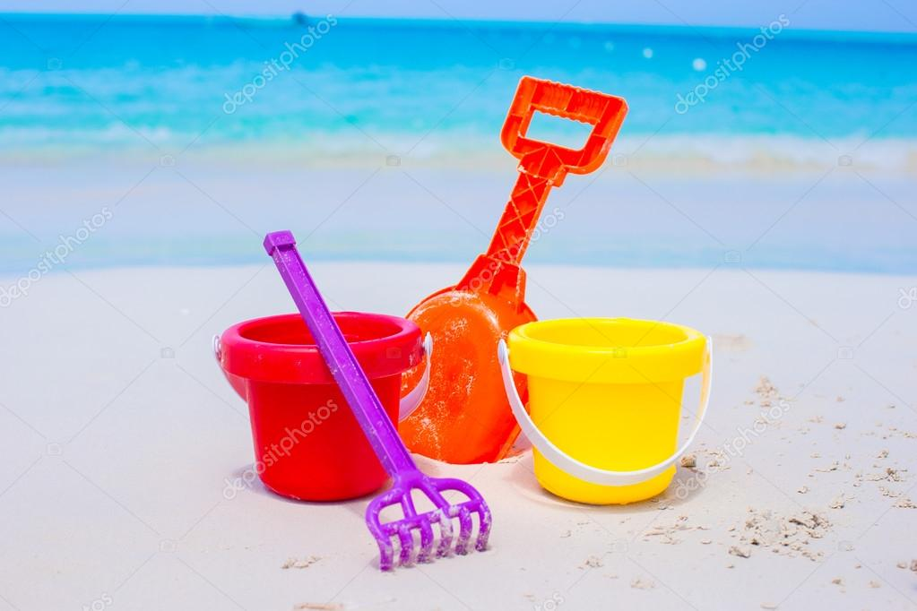 Summer kids beach toys in the white sand