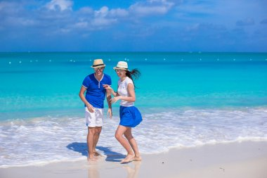 Happy couple have fun on Caribbean beach vacation