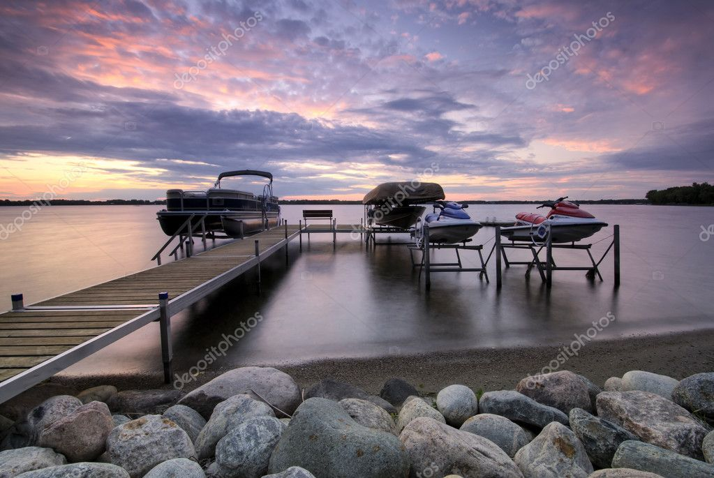 Boat dock at sunset with raised boats and jet ski's, Minnesota, USA