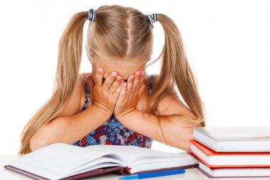 Tired little girl does homework