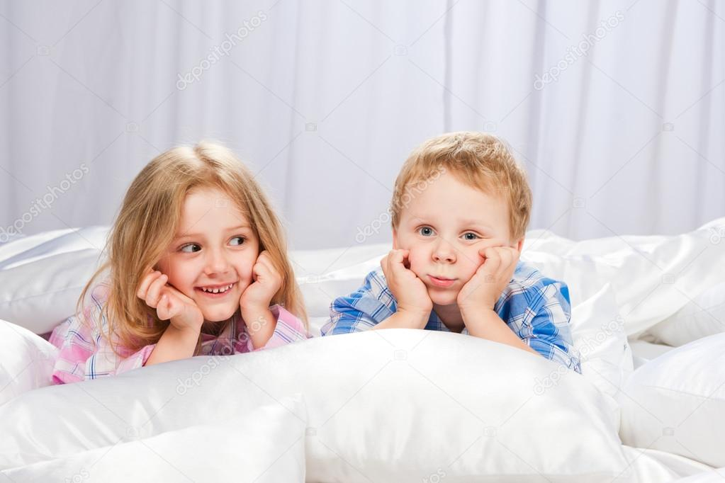 Two Merry Children Playing On The Bed U2014 Stock Photo