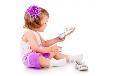 The little girl with shoes