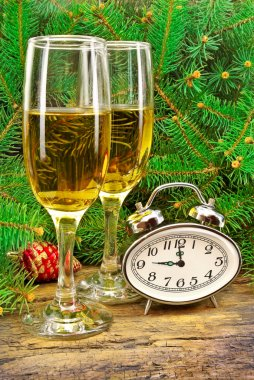 Wine glasses, watches, Christmas toys, near New Year tree.