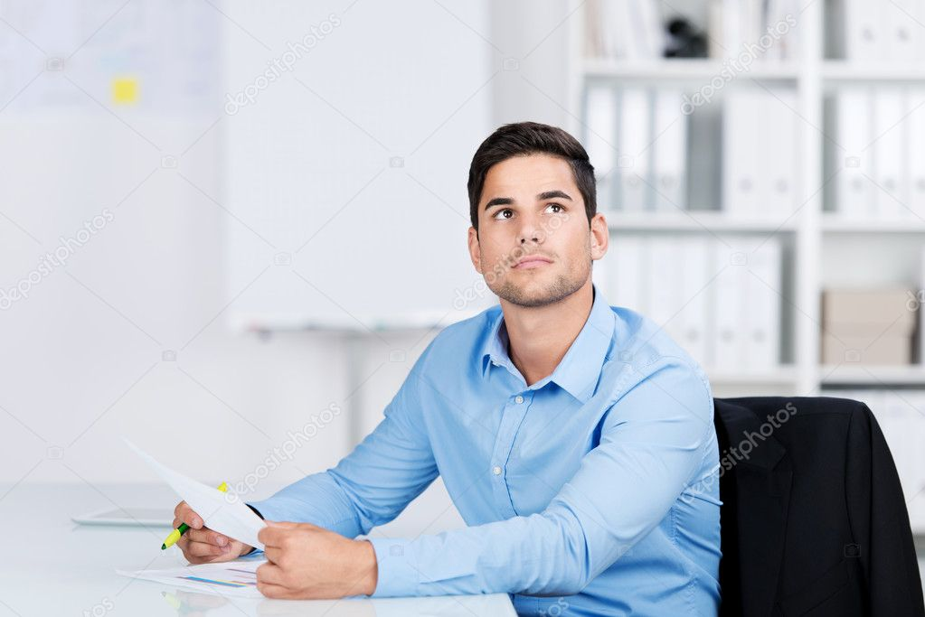 Young Man Daydreaming In The Office Stock Photo C Racorn