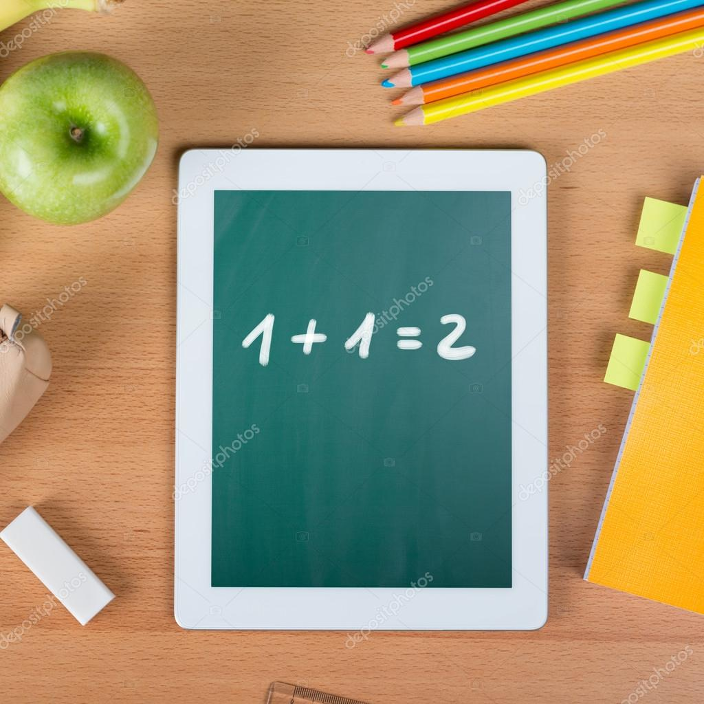 Digital tablet on a school desk with math exercise — Stock Photo ...