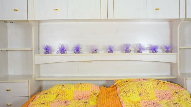 Wide shoot of Lavender on room closet as decoration in small pouches and sliding from sides. Many people appreciate lavender for its fragrance, used in soaps, shampoos, and sachets for scenting cloth