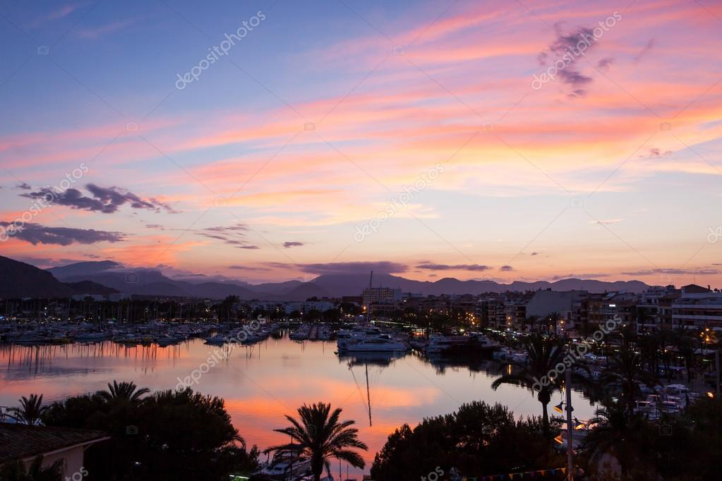 Evening sea views of the harbor, resort city and mountains