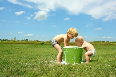 Children Playing in Bubbly Water