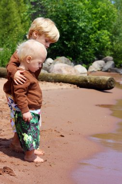 Big Brother and Baby on the Beach