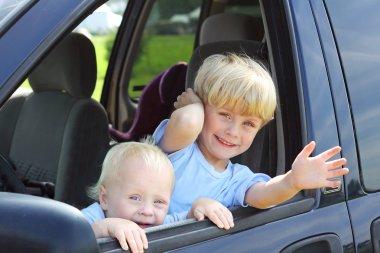 Children Smiling Out Van Window