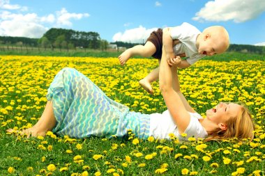 Mother and Baby Playing in Field