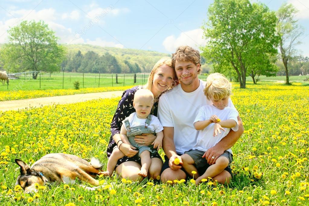 Happy Family Outside in Dandelions