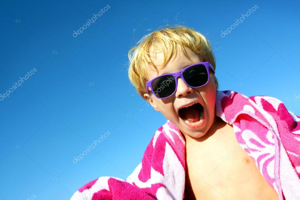 Hip Excited Child in Beach Towel and Sunglasses