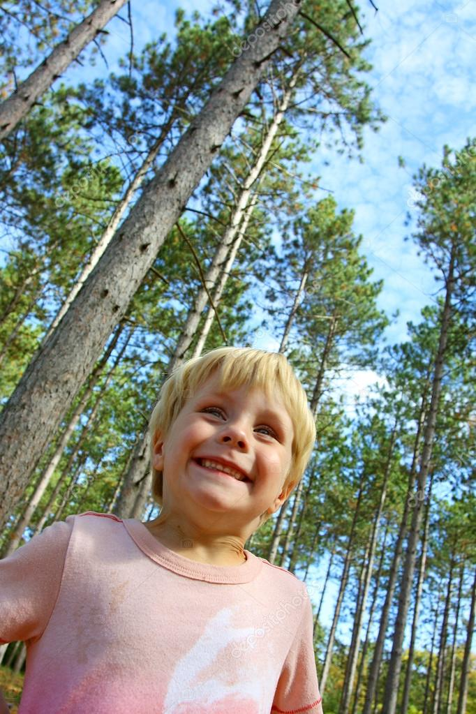 Happy Boy Standing Outside Under Pine Tree Forest