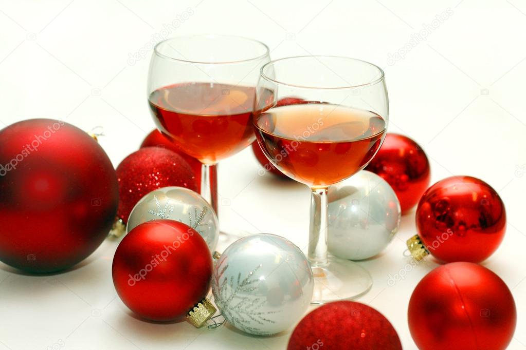 two wine glasses surrounded by christmas decorations stock photo