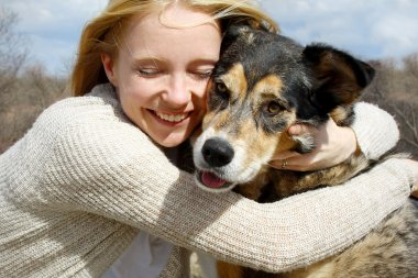 Close up of Woman Hugging German Shepherd Dog