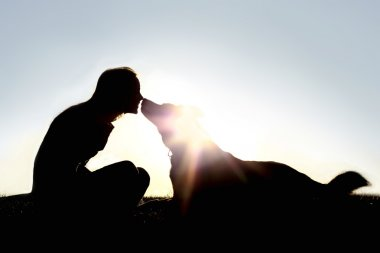 Happy Woman and Dog Outside Silhouette