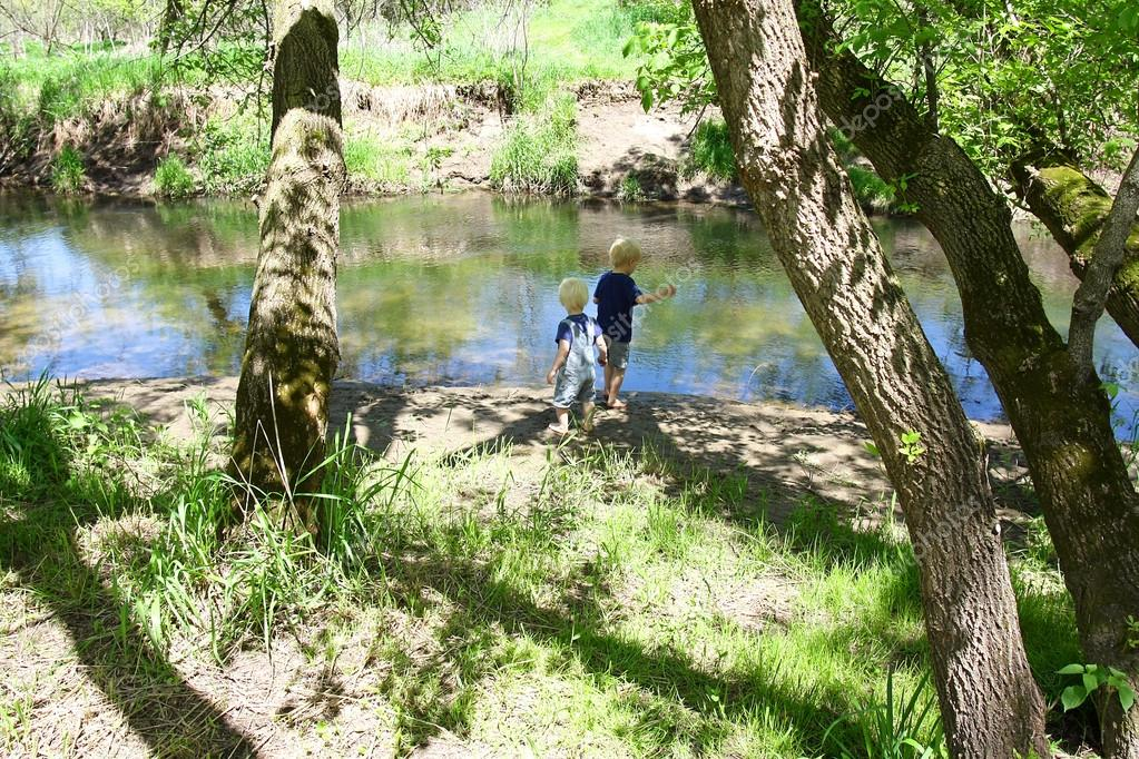 Children Playing Outside at the River