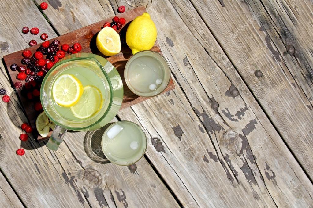 Fresh Lemonade and Fruit Framing Rustic Wood Background ...