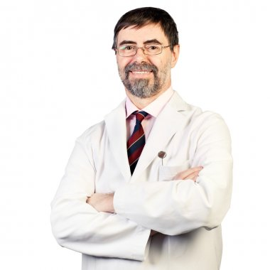 Portrait of happy middle-aged dentist on a white background, wea