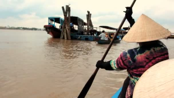 MEKONG DELTA, VIETNAM - JULY 24: woman rows a boat on a canal,