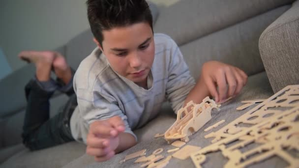 Child making mounting a car model at home