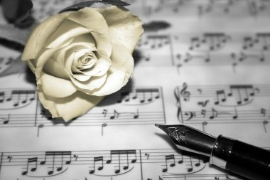 Rose on musical notes page