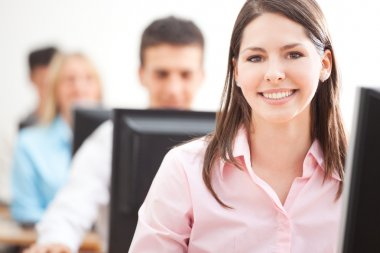 Smiling Student Using Computer