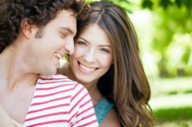 Loving Couple In Park