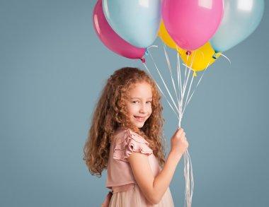 Smiling Girl Holding Balloons