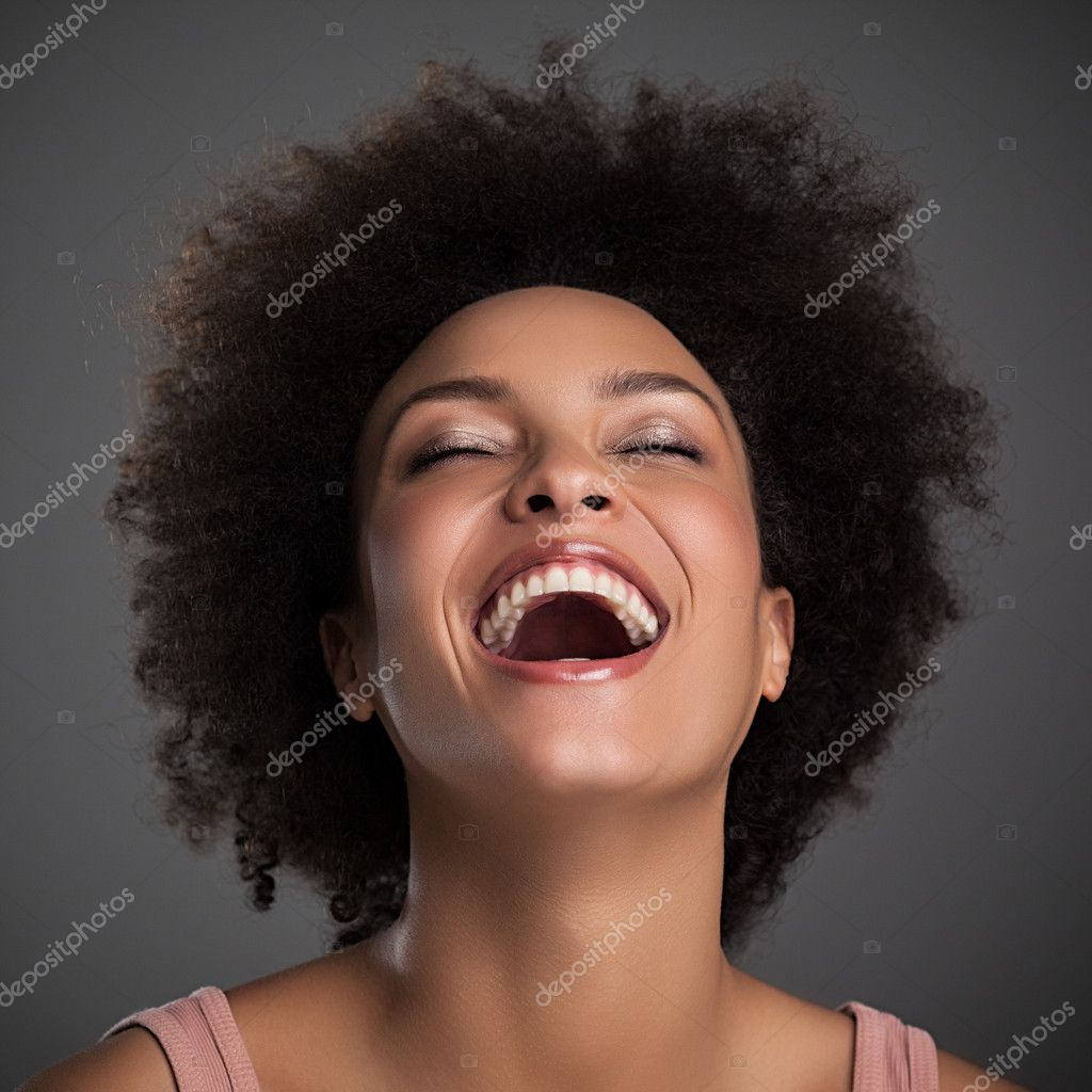 Portrait of a beautiful African woman laughing.