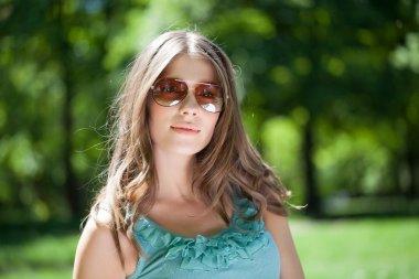 Beautiful Caucasian woman posing outdoors. stock vector