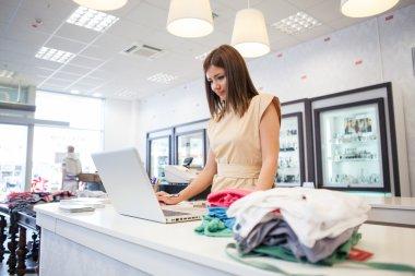 Shop Assistant at a Clothes Store