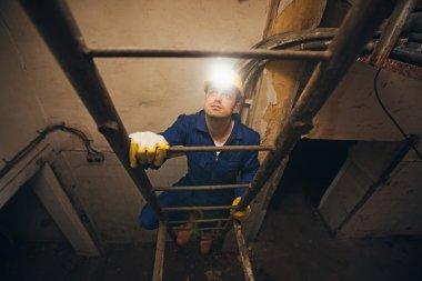Construction Worker Climbing a Ladder